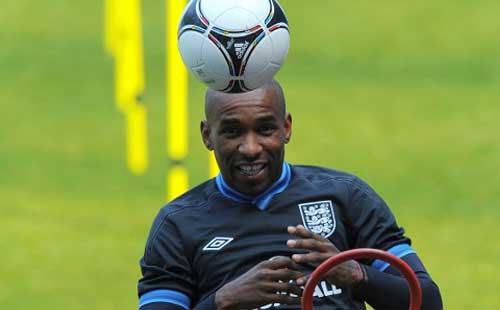 Defoe hat-trick keeps Spurs on track